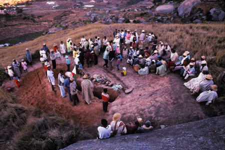 Betsileo villagers gather to worship the ancestors in a yearly ritual called Famadihana, which includes exhumation and rewrapping of remains in fresh shrouds. Some Malagasy worship the ancestors, believing all will be well in their lives if they honor and remember the ancestors.