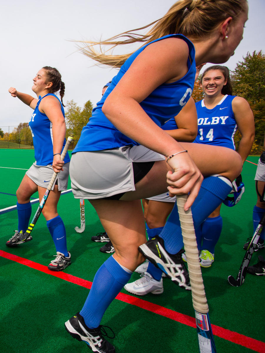 Colby College field hockey team members get pumped up before a Homecoming Weekend game on the Waterville, Maine campus. (Shot for Colby College)