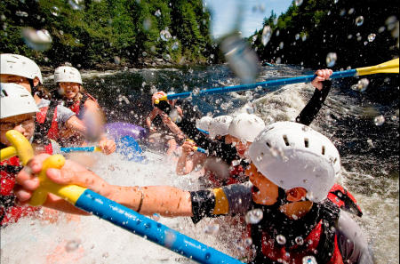 White water rafters navigate Class 3 water on Maine's Kennebec River. Shot for Time magazine.