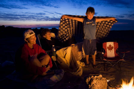 Islanders enjoy a beach campfire on Canada's Prince Edward Island.