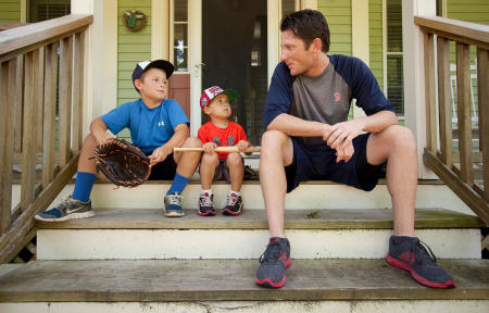 Camden and Jackson Charron,  age 9 and 4, sit on the front steps and talk baseball with Portland Sea Dogs pitcher Michael McCarthy, who lives with the Charron Family in their Falmouth home while the Red Sox AA team is in Portland.