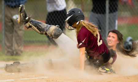 Windham catcher Sadie Nelson is on the ground after tagging Thornton Academy baserunner Taylor Paquette during fifth inning action.