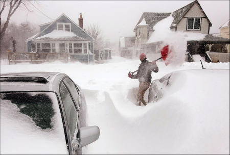 An Ocean Park resident digs out during a blizzard.