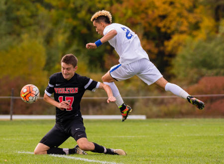 A Colby College soccer player gets air bound while making a shot during a Homecoming Weekend game against Wesleyan University on Colby's Waterville, Maine campus. (Shot for Colby College)