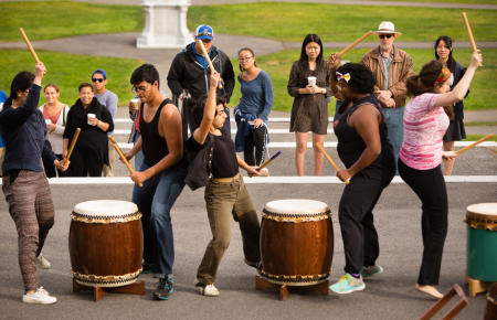 Colby College students engage in a Taiko drumming performance during Homecoming Weekend, on the steps of Miller Library on the Waterville, Maine campus. (Shot for Colby College)