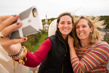 A Colby College student and her mother take a photo up on the Miller Library tower during Homecoming Weekend on the Waterville, Maine campus.(Shot for Colby College)