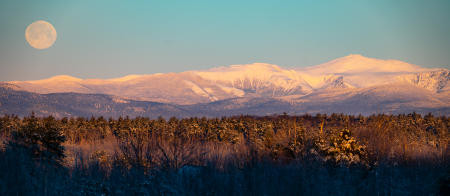 The full snow moon sets over the Presidential Range.