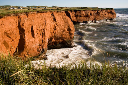 Rugged cliffs of the Magdalen Islands, part of the Quebec Canadian province, located in the Gulf of St. Lawrence.